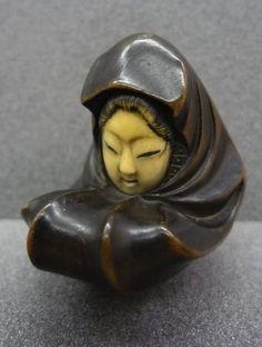 Female doll. Japanese netsuke, made of wood, ivory, by Kikusen