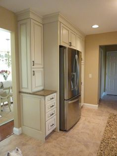 Lots of storage, Kraftmaid Marquette white cabinets  with glazing
