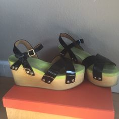 Wooden Strappy Sandal Platforms Can go cheaper on Ⓜ️ erc. Moderate wear but still good condition and has lot of life left. Wear is on foam insole and some scuffing on wood sides(pictured). Manmade upper. Hip and comfortable retro sandals! Fyi: they're a bit loud when walking in them. Platform goes from 2 inch to 3.5 inch high. Size 7 but can fit a size 6.5. Flogg Shoes Platforms