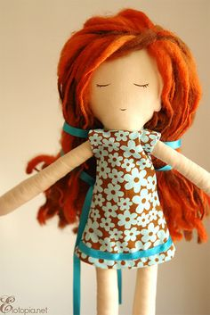 This little doll looks like it has awesome red dreads, sooo cute! not even a huge fan of human dreads but doll dreads, heck yeah! Need to make one for Loli!