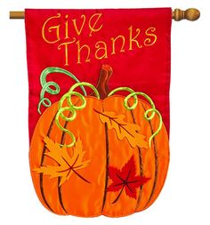 Evergreen Thanksgiving outdoor house flag with a rich red background mixed with gold and orange leaves and pumkins.  Free shipping on $49 orders
