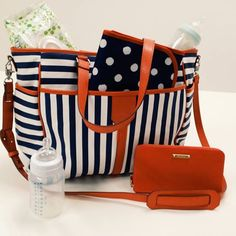Most stylish Baby Bag of ALL TIME! Love it! Comes with coordinating baby changing mat, buggy clips, elastic pocket for bottle, pacifier clip, pockets for nappies, etc. and is just super cute: http://www.stelladot.co.uk/shop/en_gb/p/accessories/designer-handbags-wallets/keep-it-in-the-bag-navy-stripe?s=kateg