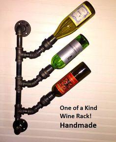 Industrial Black Pipe Wine Rack Bottle di PipeLineDesignStudio