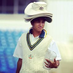 Lisa Sthalekar carries the drinks & the entire team's broad brims early in her career