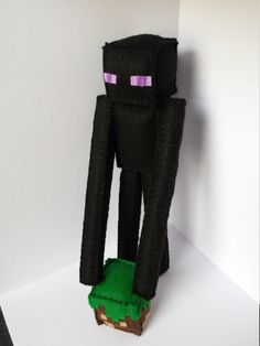 Made-to-order Minecraft Enderman.  He is 100% handmade, from start to finish. Each piece is cut to scale and hand stitched together. Measuring just short of 11 tall, he would sit perfectly next to the computer monitor or desk. Please select from menu if you want the dirt/grass block with your Enderman. Additional sizes can be made, please message me for prices.  Made using Eco-friendly Felt, matching colors of 100% cotton embroidery floss, and gently stuffed with hypoallergenic polyester...