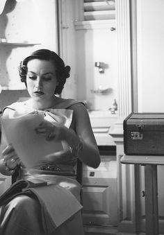Joan Crawford studies on the set of No More Ladies, 1935