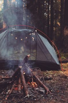 Beautiful campsite with a fire burning and a see through tent so you can truly enjoy nature.