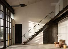 House and photography studio by Olson Kundig with pivoting steel doors