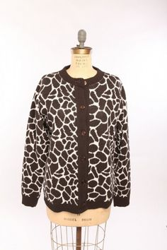 Giraffe Cardigan made from 75% pre-consumer recycled cotton and 25% acrylic. Manufactured in the USA. http://www.green3apparel.com/women/sweaters/giraffe-cardigan/ $90