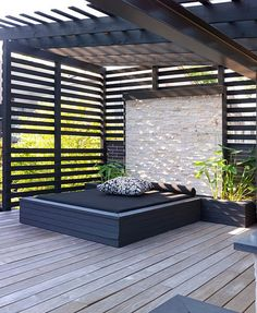 Slated wood details and outdoor seating.