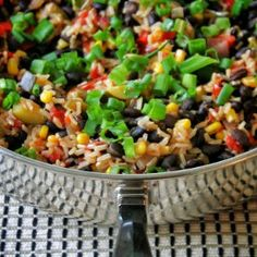 Alexander house notes:  This needs more spice.  Black Beans and Rice Veggie Skillet:  onion, red & green pepper in olive oil.  add garlic, can diced tomatoes, 1c corn, 1c brown rice, 1 3/4 c water.  cook 35 min.  add can black beans (drain & rinse)  turn off heat, let stand 7 min.  garnish w. green onions