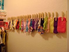 use this idea for headband and hat storage  http://scacchihouse.wordpress.com/2012/02/07/diy-headband-holder/