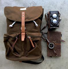 Grab a #daypack, #camera, #travelersnotebook, your usual #everydaycarry & have a #rugged weekend!  We've gone for a #sandqvist Roald backpack in olive green, a vintage #rolleiflex & our nicely worn #midoritravelersnotebook. #backpack: https://www.nomadostore.com/collections/sandqvist-bags-accessories/products/sandqvist-roald #notebook : https://www.nomadostore.com/collections/travelers-company-japan #ruggedstyle l #nomadostore #stationery #analog #canvasandleather #nomadostore #stationery…
