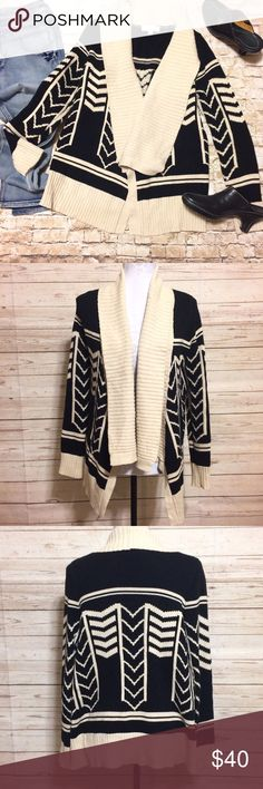 Olive & Oak Drapey Open Cardigan Cozy and warm open-front drapey cardigan by Olive & Oak is in excellent used condition. Beautiful knit in black and cream with long sleeves, Tunic length and a shawl style front drape. This is the perfect cardigan whether you're heading to work, going out with friends, or my favorite: snuggling up with a book and coffee. Olive & Oak Sweaters Cardigans
