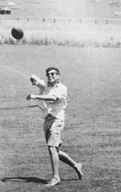 "John F. ""Jack"" Kennedy tossing a football."