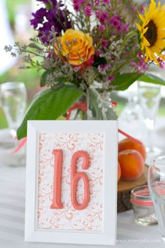 wildflower mix in a mason jar with cute table numbers