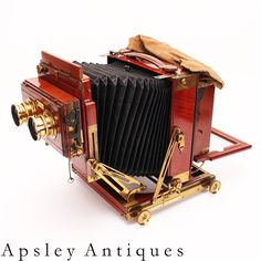 Thornton Pickard Royal Ruby triple extension brass & mahogany half plate stereo field camera . www.fgphotographica.com