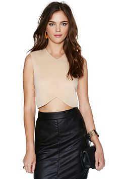 What's wrong with thinking inside the box? Especially when it comes to a boxy fit like this!  This crop top has a v-neckline, architectured angles, curving hemline, and yes-- super boxy silhouette, to make your look tough and sexy at the same time.