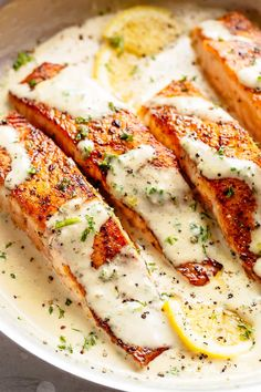 How To Cook Salmon In A Mouthwatering Garlic Butter Cream Sauce! Deliciously seasoned, pan seared salmon filets — juicy and tender on the inside with perfect crisp edges. Smothered in a gorgeous garlic butter sauce with Sauce Recipes, Fish Recipes, Seafood Recipes, Cooking Recipes, Healthy Recipes, Delicious Recipes, Bread Recipes, Recipies, Pescado Salmon