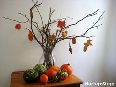 Would be cool to paint a branch a bronzy color and then tie fall colored ribbons for sale at the fall festival.