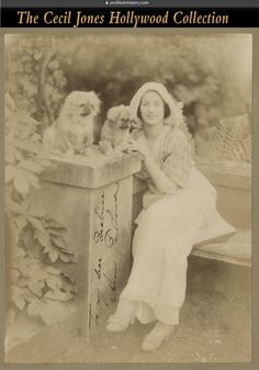 """Anna Pavlova - Signed photograph to Anna Pavlova's first protégé ballerina Beatrice Collenette. (ca. 1910s) Vintage 6.75 x 9 in. photographic portrait of Pavlova and her dogs tipped to backing board and inscribed, """"To my dear Beatrice, Anna Pavlova"""". NOTE: This photo came from an archive of Collenette's ephemera that I acquired from her daughter. Collenette retired to Southern California during World War I, opened a dance studio and had many students including Marilyn Monroe."""