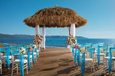 This rustic thatched gazebo is the perfect setting for a ceremony by the sea at Secrets Vallarta Bay. #UnlimitedRomance