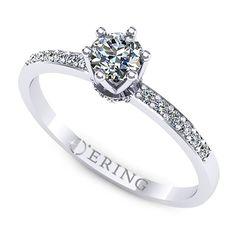Inelul este realizat din aur alb 14k</span>, greutate: ~1.80gr.                                     Produsul are in componenta sa: 1 x diamant, dimensiune: ~4.00mm, greutate: 0.25ct , culoare: G, claritate: VS2, forma: round  6 diamante, dimensiune: ~1.10mm, greutate totala: ~0.04ct, forma: round  12 diamante, dimensiune: ~1.30mm, greutate totala: ~0.12ct, forma: round