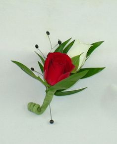 Red & White Mini Roses Boutonniere. Item # HEF-BT04. Accented with black rhinestones are one red and one white miniature rose.