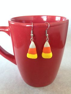 It's that time of year again! It's finally socially acceptable to eat candy corn!!  Candy Corn Earrings by EmilyTomasik on Etsy