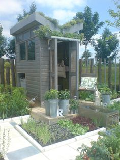 The amazing Butterfly Pavilion by Claire Potter Design.  A butterfly roofed structure which has an internal planting bench clad in recycled aluminium, a solar panel in the green roof, recycled plastic windows and recesses for a small beehive and wormery.