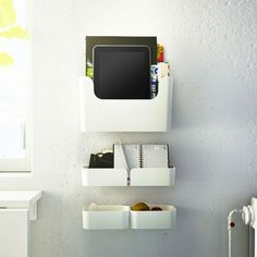 You do everything in the kitchen - cook, eat, bake, surf and play. Because when space is small, ideas get bigger - like the PLUGGIS tablet storage on the wall.