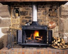 Wood burners (stock image) are emitting pollutants that are fuelling a health crisis killing 40,000 people a year, according to a landmark report