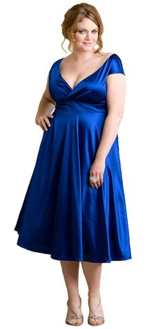 Gorgeous neckline for this cocktail dress. The empire waist and flared style are perfect for apple body shapes.