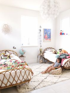 Those beds are incredible!! They will be the perfect masterpiece in a boho-inspired kid's room decor. I really like the look of the large rug, that goes from one bed to another.