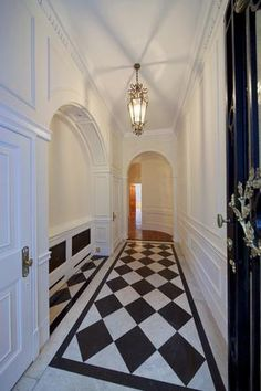 black and white tile floors, arched doors - always love.