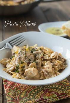 A homemade version of Macaroni Grill's Pasta Milano. A creamy garlic and sundried tomato sauce, with chicken and mushrooms, over bowtie pasta.