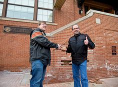 Bill Davidson, great-grandson of William A. Davidson, right, hands a brick to Sturgis, S.D., Mayor Mark Carstensen after its removal from the historic Milwaukee headquarters using a 2015 Harley-Davidson Street® 750 motorcycle. In the spirit of this year's 75th Sturgis Motorcycle Rally, that brick, alongside one from the Harley-Davidson Museum and 73 bricks from the headquarters' famous motorcycle-only parking area, will be incorporated into a new plaza on Main Street in Sturgis.