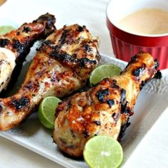 Chipotle Mango Chicken Drumsticks drizzled with lime juice and served with a creamy dipping sauce.