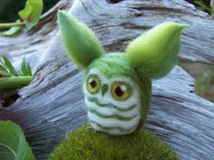 Giveaway.  You could get this cute little needle felted owl by entering this contest from the Rochester NY Etsy Street Team