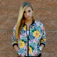 Modern Floral - A bold, green floral print transforms a classic bomber/varsity style jacket with a zip front, black elastic trim and front p... www.comostreet.com