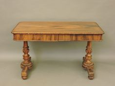 A William IV rosewood library table, with two drawers, on a pair of end columns Sold for £580 on 21st October 2015