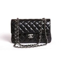 One day I will own a Chanel 2.55 Flap Bag. Black leather, silver hardware.