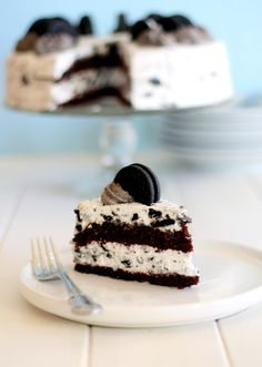 This Oreo Cake has two layers a rich, moist chocolate cake filled and covered in a light Oreo whipped cream frosting! It makes a great birthday cake.