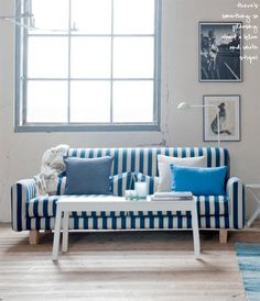 Nautical stripe sofa cover.  Future couch slip cover?