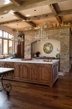 Reclaimed ceiling beams and wide plank reclaimed wood flooring are a great combination in this traditional kitchen.
