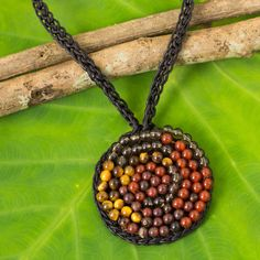 NOVICA Smoky Quartz, Carnelian, and Onyx Crocheted Necklace ($30) ❤ liked on Polyvore featuring jewelry, necklaces, carnelian, pendant, carnelian necklace, beaded pendant necklace, beaded jewelry, spiral pendant and smoky quartz pendant necklace