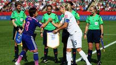 Aya Miyama of Japan and Steph Houghton of England shake hands for peace