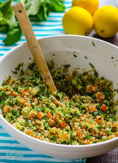Quinoa Tabbouleh Salad Recipe -- Refreshing quinoa salad chock full of fresh garden vegetables. Keeps your kitchen cool and can be prepped ahead, which makes it perfect for a potluck or a backyard party.