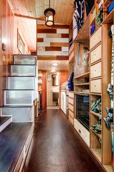 Lots of storage for the tiny house owners' outdoor gear, plus accommodations for their dogs!