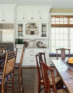 """Use a Striped Rug:   """"Put a striped rug over your solid-color carpet to create a new feeling in any room."""" -Scott Sanders    An understated striped rug was placed below a table in the kitchen of a New Jersey home."""
